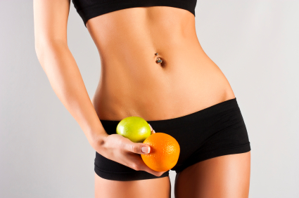 Concept of a healthy body. Thin belly, fruit